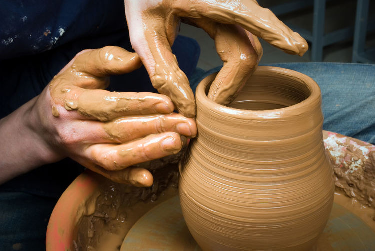 Cropped Image Of Potter Making Clay Pot