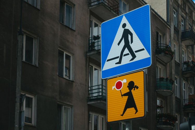 Travel Travel Photography Architecture Building Building Exterior Built Structure City Communication Day Direction Guidance Human Representation Information Information Sign Information Symbol Male Likeness No People Outdoors Pedestrian Crossing Sign Representation Road Road Sign Sign Symbol