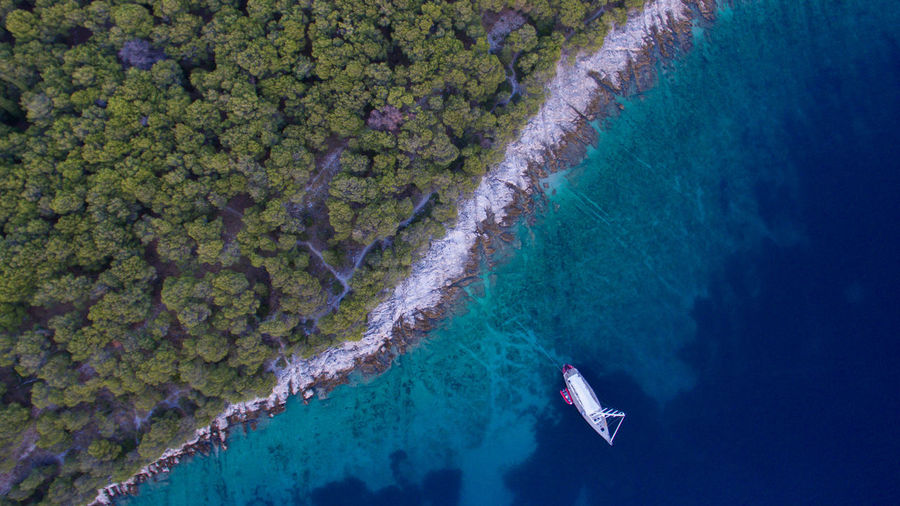 Croatia Dark Drone  Seashore Trees Beauty In Nature Blue Boat Clear Water Dronephotography Dronepointofview High Angle View No People Scenics - Nature Sea Turquoise Colored Water