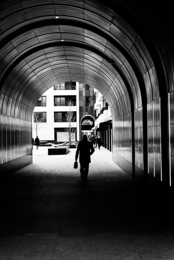 Arch Arched Architecture Built Structure Ceiling Day Direction Footpath Full Length Indoors  Lifestyles Light At The End Of The Tunnel Men One Person Real People Rear View Silhouette The Way Forward Transportation Tunnel Walking