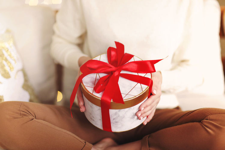 Midsection of woman holding gift box