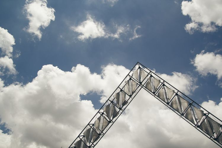 Low Angle View Of Construction Frame Against Cloudy Sky