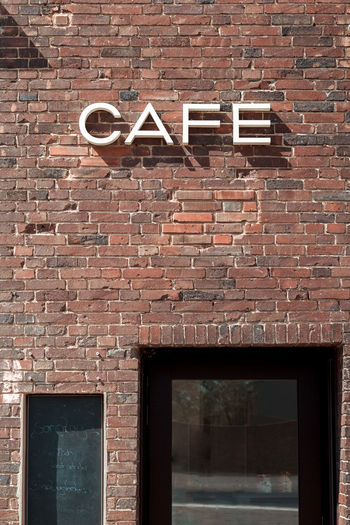 coffeetime Architecture Brick Brick Wall Brown Building Building Exterior Built Structure Cafe Day Low Angle View No People Old Outdoors Pattern Restaurant Sign Text Wall Wall - Building Feature Western Script Window Wood - Material