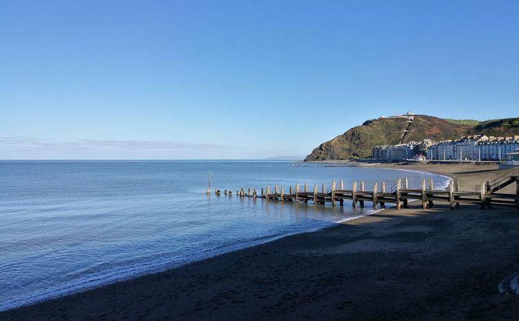 Welsh Coast Aberystwyth Coastal Landscape Sea Side West Wales Sea And Sky Seascape Blue Blue Water Blue Sky Ceredigion Tranquil Scene Sky West Coast Coastal Feature Outdoors Aberystwyth Beach Sand Pile Sea Beauty In Nature