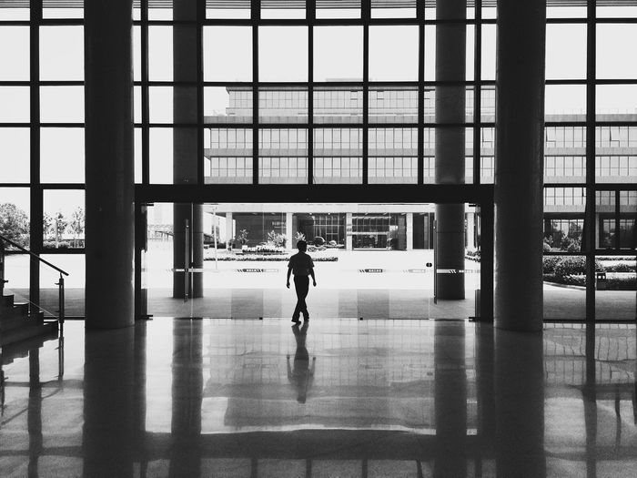 Silhouette Man Walking In Building