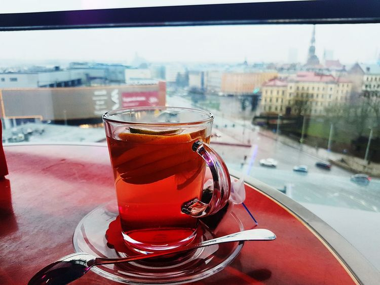 Morning in Riga Travel Buisness Stories Let's Go Day No People Cup Cup Of Tea Tea Tea Time Glass City Background Sky Car Fruits Orange City City View  Riga Origo Latvia Europe Eu Good View Building Cafe Mobility In Mega Cities Colour Your Horizn