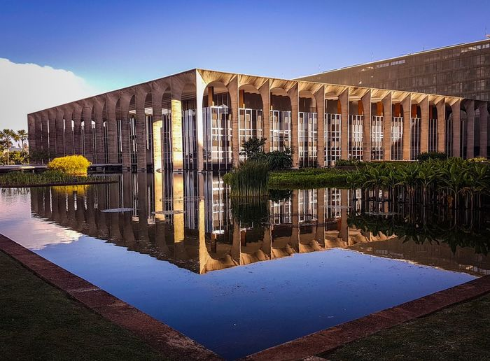 Brasilia, Brazil - 04 January, 2017: Itamaraty Palace, Ministry of Exterior Relations and Unesco World Heritage site. Reflection Water Architecture Built Structure Building Exterior Waterfront Nature Outdoors Sky Clear Sky No People Day Itamaraty Brasília Urban Design, Geometrical Shapes, Colorful Geometrical Shapes, Urban Art, Urban Geometry, Urban Art, Politics And Government Brazil UNESCO World Heritage Site Oscar Niemeyer Niemeyer Architecture Facades And Light ARCHITECT Urban Planning Arches Architecture