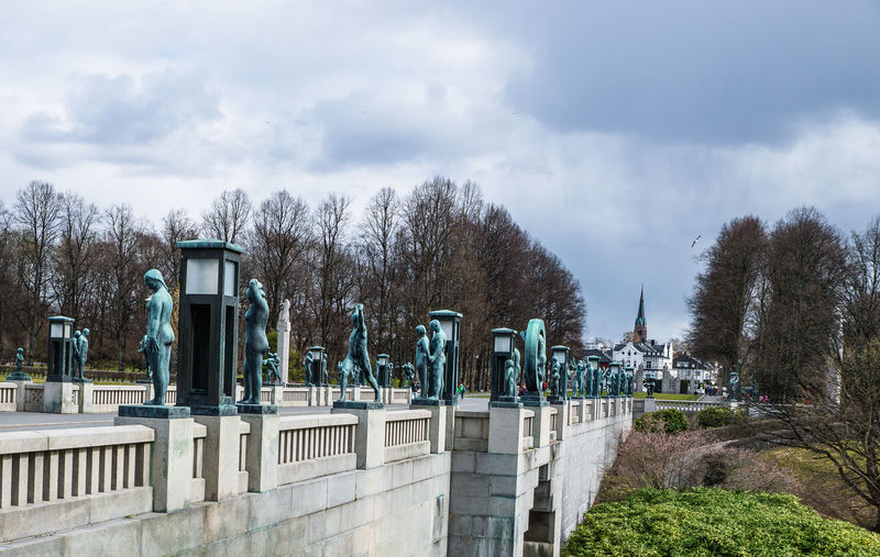 Sculptures In Vigeland Park Against Cloudy Sky