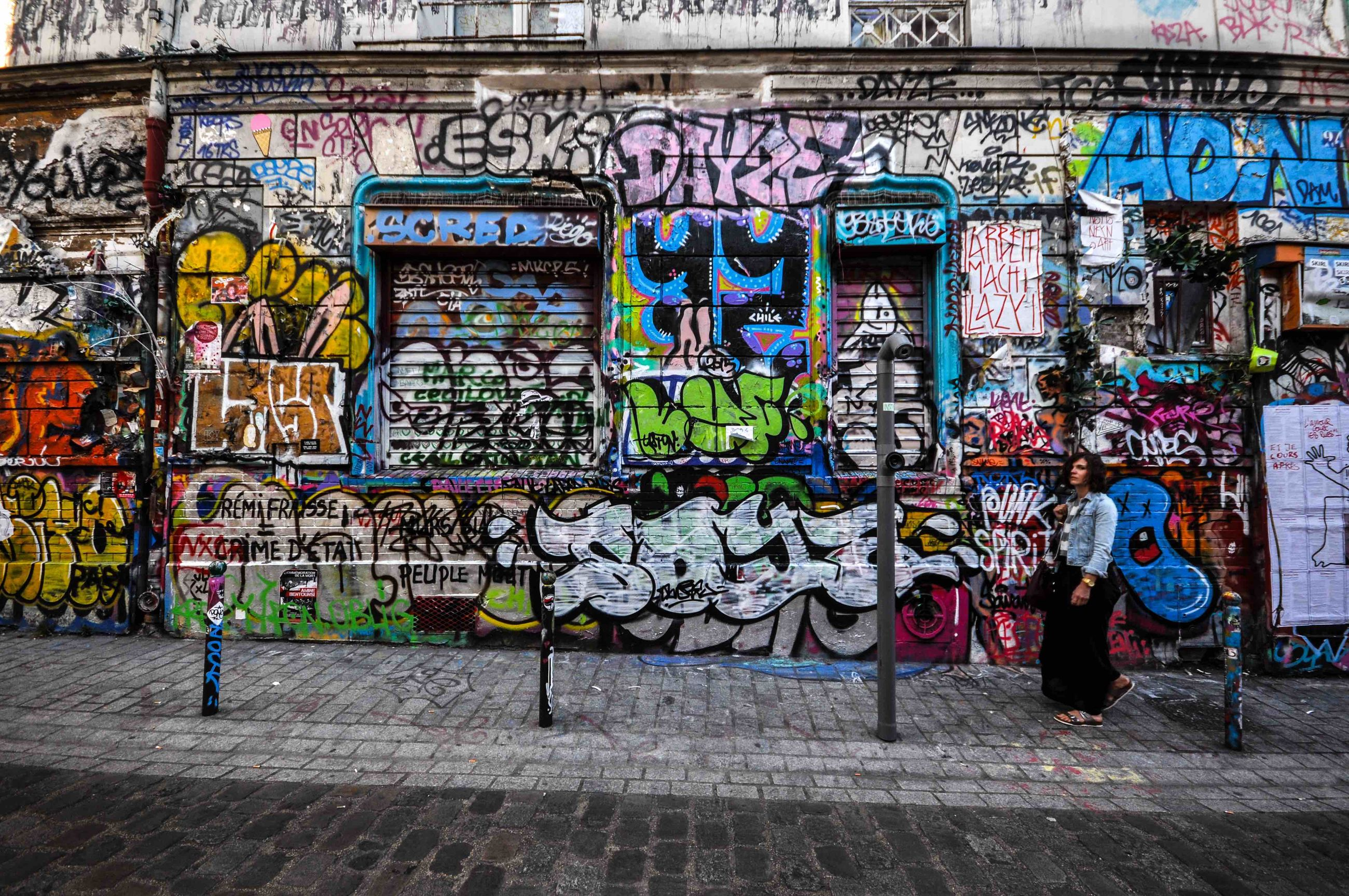 graffiti, built structure, architecture, art, art and craft, wall - building feature, creativity, text, building exterior, multi colored, street art, western script, vandalism, wall, mural, communication, street, human representation, day, non-western script