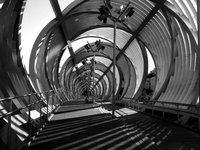 City Arch Sunlight Architecture Built Structure Covered Bridge Tunnel vanishing point Diminishing Perspective Architectural Design Arched Underpass Light At The End Of The Tunnel The Way Forward Passageway Empty Road Elevated Walkway Footbridge EyeEmNewHere