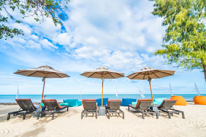 Beach Beauty In Nature Chair Day Group Of Objects Horizon Over Water Nature No People Outdoors Relaxation Sand Scenics Sea Sky Summer Table Tranquility Vacations Water