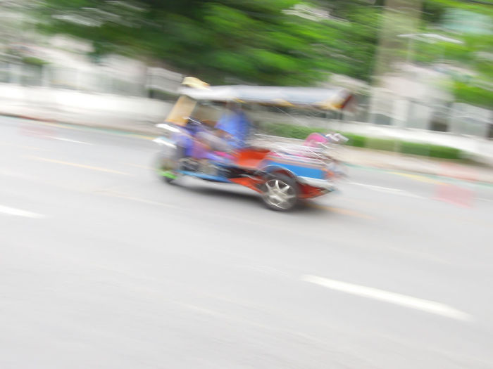 Blurred motion of vehicles on road