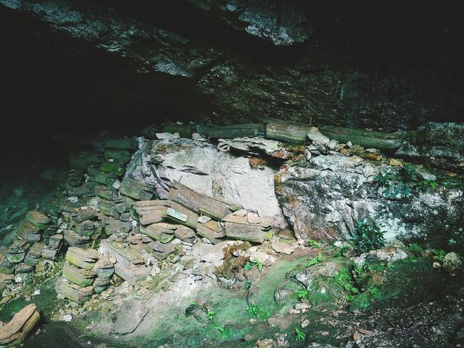 Day No People Sand Outdoors Nature Close-up Cave Burial Chamber Burial Ground Burial Site Burial Grounds Hanging Coffins Coffins In Caves