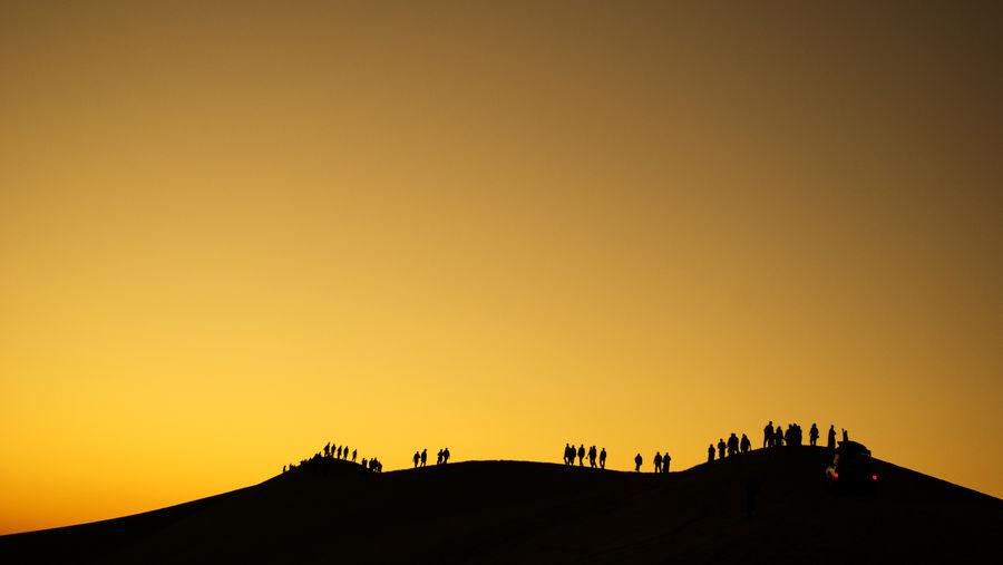 Desert Tourist Attraction  Beauty In Nature Dusk Landscape Orange Color Outdoors Silhouette Sky Sunset