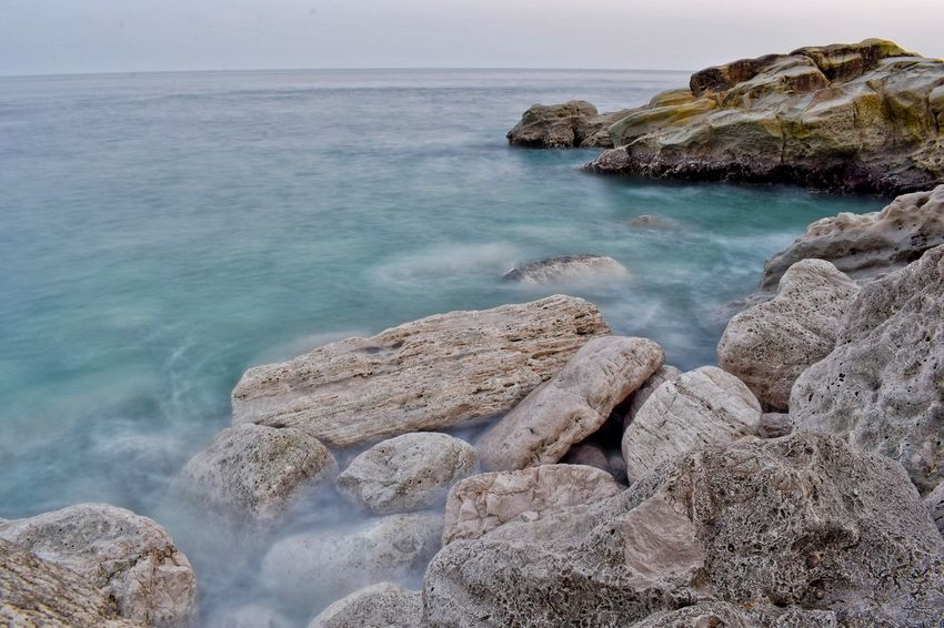 Sea Beach Horizon Over Water Rock - Object Outdoors Nature Coastline Scenics Coastal Feature Beauty In Nature Water Day No People Sky Nikond3300 Tranquility Tranquil Scene Travel Destinations Nikon D3300 Longexposurephotography Rock Rock Formation Sea And Sky Landscape Sunset