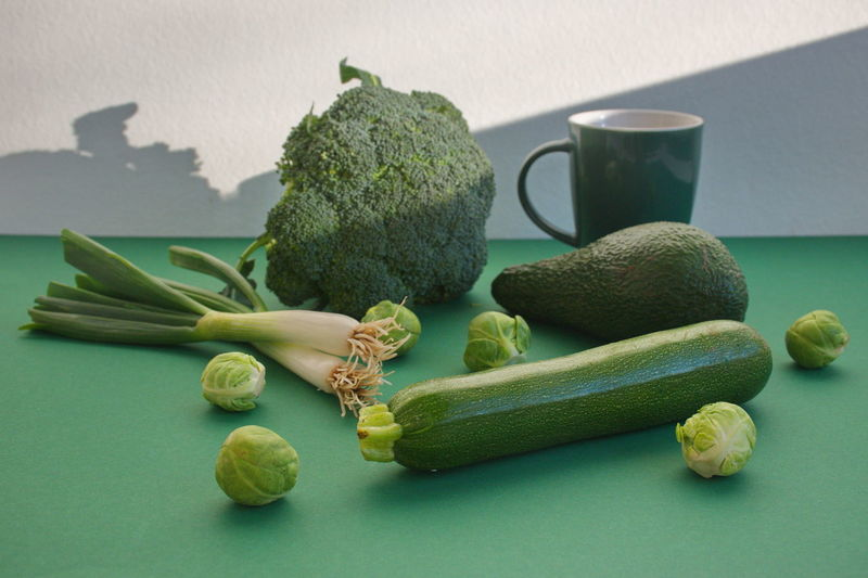 Food And Drink Healthy Eating Green Color Food Wellbeing Freshness Still Life Vegetable Indoors  No People Table Raw Food Broccoli Colored Background Close-up Variation Studio Shot Pumpkin Avocado Cup Onion Shadow Organic Natural Diet