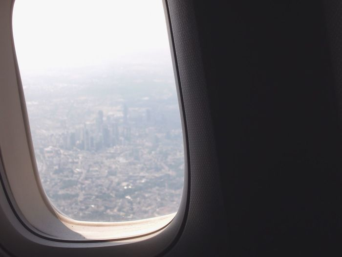 View of cityscape seen through airplane window