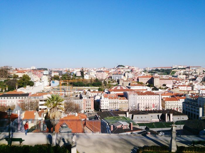 High angle shot of townscape against clear blue sky