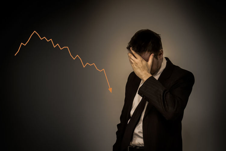 Stocks plummeting - failed business man holding his hand on his face Business Businessman Depressed Disappointment Facepalm Failure  Finance Graph Markets One Person Plummet Plummeting RISK Risky Business Stock Market And Exchange Stocks Suit Well-dressed First Eyeem Photo