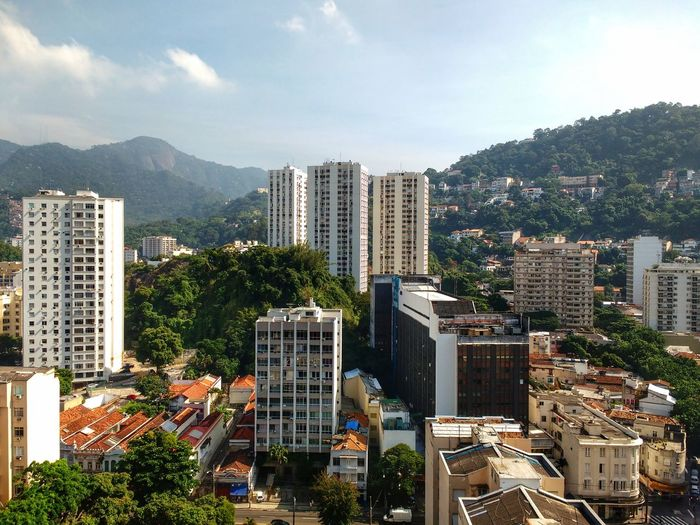 Houses and hgh-rise apartments surrounded by an urban mountain forest in Laranjeiras, Rio de Janeiro. Skyscraper Cityscape Architecture City High Angle View No People Urban Skyline Mountain Outdoors Day Sky Capital Cities  Urban Jungle Landscape Travel Destinations Mountain Range Brazilian Metropolis Latin America South America Horizon Tropical Scenics Nature Tourism The Great Outdoors - 2017 EyeEm Awards