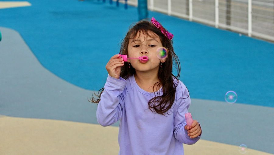 Portrait Of Happy Girl By Swimming Pool