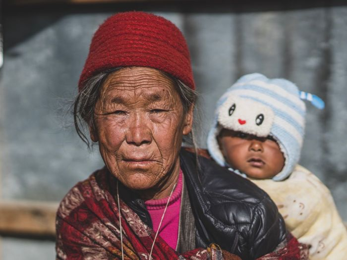 Tibet Asian  Portrait Of A Woman Streetphotography Himalaya Tibetan  Nepal Travel Nepal Tibetan Village Tibetan Buddhism Street Photography Portrait Photography Portrait Headshot Clothing Childhood Focus On Foreground Knit Hat Close-up Hat Adult Child People Indoors  Real People Front View Looking At Camera Two People Representation Day EyeEmNewHere The Portraitist - 2018 EyeEm Awards