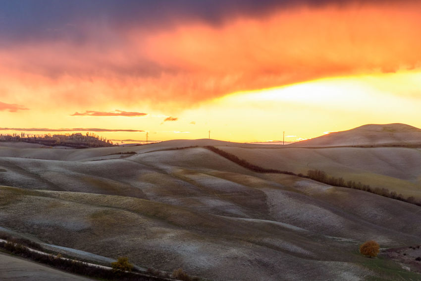 Crete Senesi Torre A Castello Tuscany Tuscany Countryside Beauty In Nature Cloud - Sky Cold Temperature Day Dramatic Sky Europe Italian Landscape Mountain Nature No People Orange Color Outdoors Salt - Mineral Scenics Siena Sky Snow Sunset Tranquil Scene Tranquility