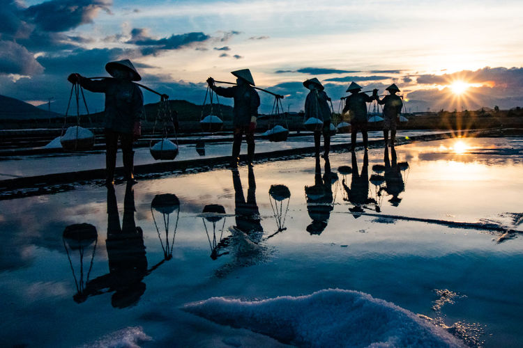 Salt Fields, Farmland Farm Life Salt Harvesting Vietnam Vietnamphotography Golden Hour Sunset Sunburst Salt Basket Salt Bae Manual Labor Silhouette Wide Angle Silhoutte Photography Moody Reflections In The Water Reflection Dusk Nha Trang, Vietnam Travel Photography EyeEmNewHere My Best Photo