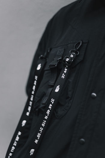 Black Color Close-up Clothing Indoors  No People Jacket Gray Copy Space High Angle View Gray Background Single Object depth of field EyeEm Best Shots Detail Fashion Street Fashion Streetphotography Streetwear Monochrome THE NORTH FACE