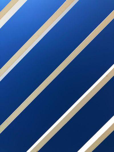 Full frame shot of metallic structure against blue sky