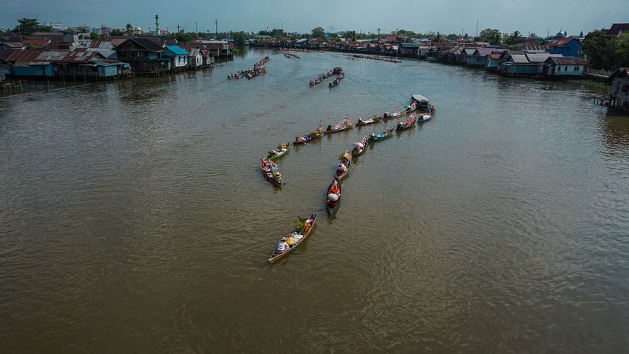 High angle view of people on boat in river