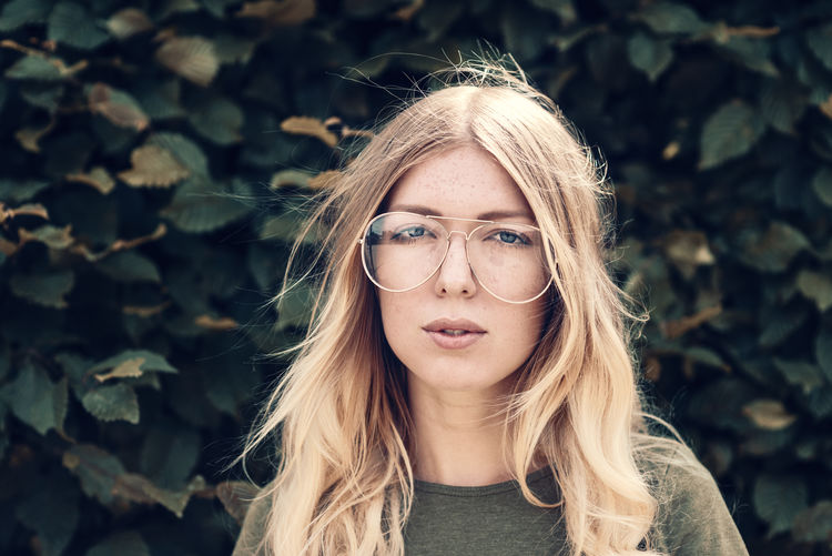 Young women with long blond hair Cool EyeEm Best Shots Fashion Glasses Lifestyle Millenials Portrait Of A Woman Retro TwentySomething Accessories Blond Hair Coolness Eyewear Germany Hipster Look Model Outdoors Vintage Windy Women women around the world Women Of EyeEm Young Adult Young Women International Women's Day 2019