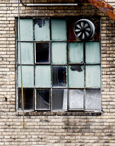 old window with ventilator Building Exterior Architecture Window Built Structure Old No People Wall Brick Wall Building Day Brick Wall - Building Feature Outdoors Glass - Material Pattern Geometric Shape Closed House Residential District Abandoned Exhaust Fan Ventilation Industrial