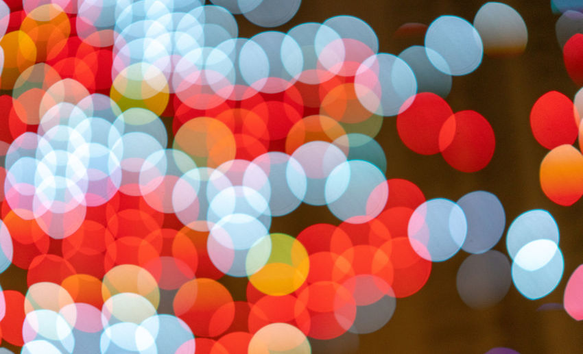 Illuminated Defocused Backgrounds Night Multi Colored Celebration Geometric Shape Decoration Glowing No People Large Group Of Objects Pattern Abstract Circle Shape Lighting Equipment Spotted Light - Natural Phenomenon Sphere Vibrant Color Light Purple Brightly Lit