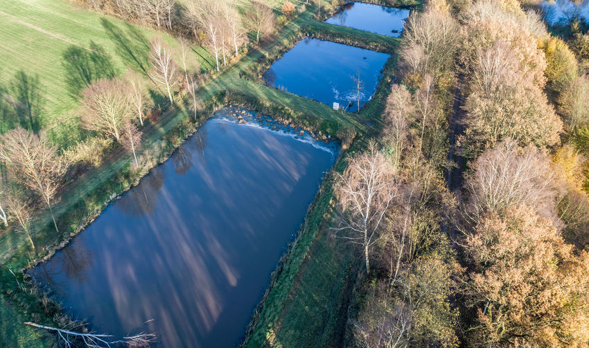 Aerial view of a trout farm with three fish farms, near Wolfsburg, Germany, aerial view with drone Basin Drone  Drone Dji Aerial Aerial View Beauty In Nature Dam Day Fishfarm Growth High Angle View Mountain Nature No People Outdoors Plant River Scenics Sky Tranquil Scene Tranquility Tree Trout Water Waterfront