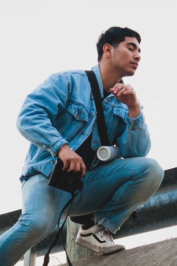 Reckless Teen Close Up Careless Colors Photography Contrast Jean Jacket Sitting One Man Only One Person Only Men Jeans Casual Clothing Fashion Stories Young Adult Young Men Men Handsome Portrait Day Leisure Activity People