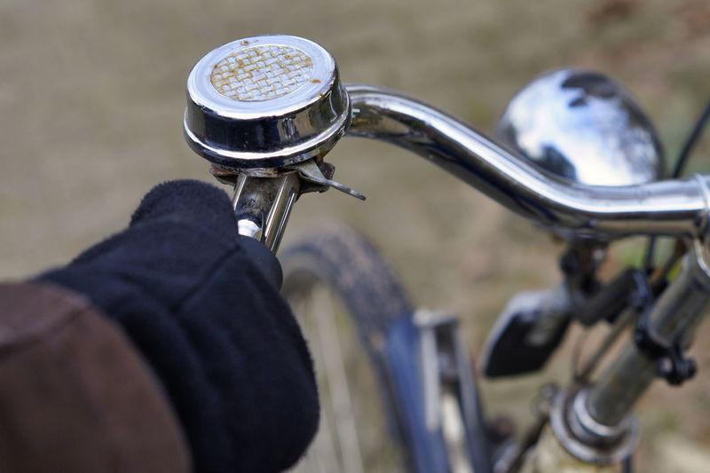 Close-up of human hand holding bicycle handlebar