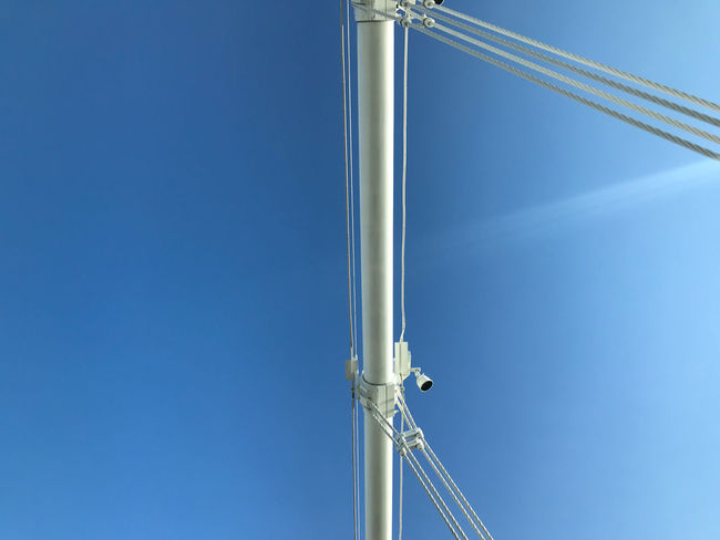 detail close up of cables of San Francisco - Oakland Bay Bridge, with blue sky, and sun flare Sky Blue Clear Sky Copy Space No People Day Low Angle View Nature Metal Built Structure Architecture Sunlight Connection Tall - High Cables Bridge Detail White Directly Below