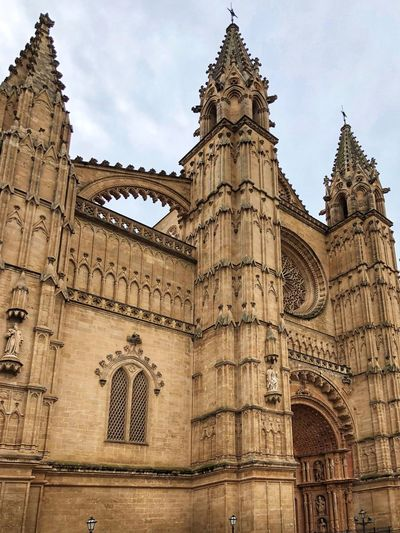 Exterior of the Cathedral de Mallorca, La Seu Exterior Palma De Mallorca Cathedral Architecture Built Structure Building Exterior Low Angle View Travel Destinations Sky History The Past Travel Tourism Building City Religion Belief Place Of Worship Spirituality No People Outdoors Day