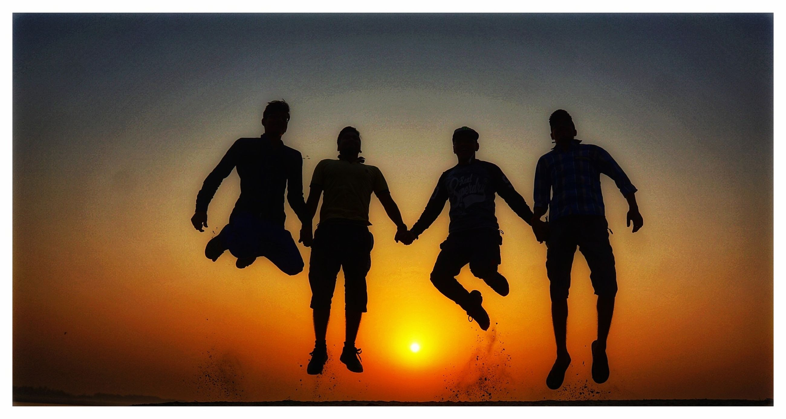 group of people, sky, sunset, auto post production filter, transfer print, orange color, leisure activity, silhouette, togetherness, full length, men, nature, lifestyles, real people, friendship, walking, people, sea, clear sky