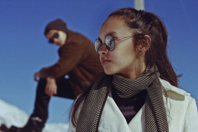 Man and woman in sunglasses against sky