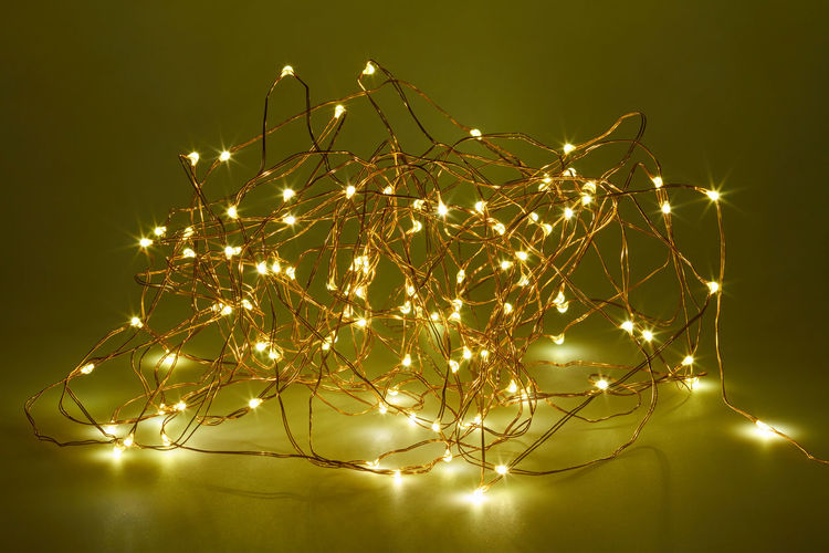 Close-Up Of Illuminated String Lights On Table
