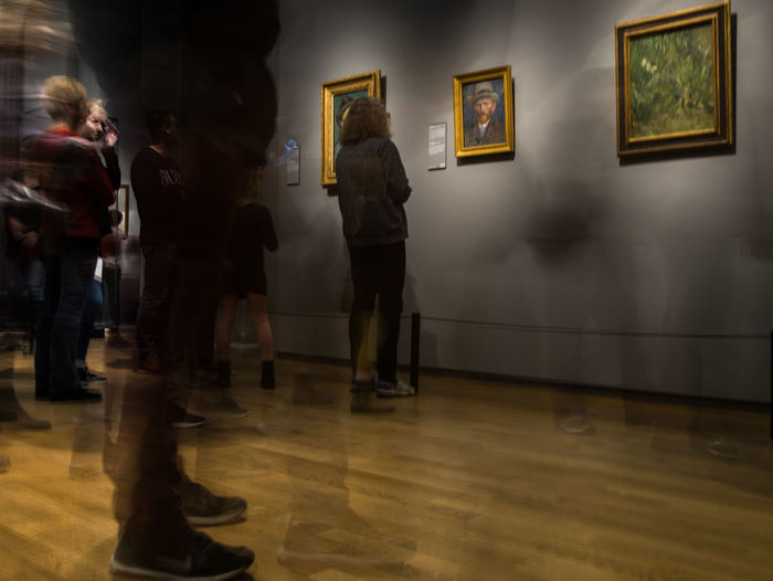 Flooring Indoors  Museum Architecture Real People Group Of People Men Leisure Activity Art Museum Lifestyles Exhibition Paintings Blurred Motion Wall - Building Feature Full Length People Illuminated Arts Culture And Entertainment Picture Frame Standing Van Gogh