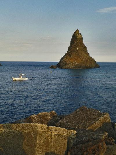 Acitrezza  Sicily Blue Boat On Water Evening Island Malavoglia Rocks Sea Verga