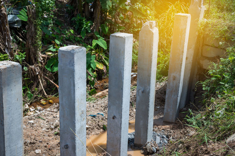Retaining wall construction. Protecting riverbank collapse,concrete pile foundation is the most important part. Concrete Pile Construction Site Digging Equipment Foundations Pile Retaining Wall Riverbank Sunlight