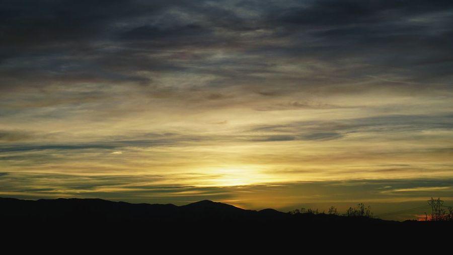 Silhouette Cloud - Sky Sunset Beauty In Nature Nature Sky Dramatic Sky Scenics No People Outdoors Mountain Alpha6000 Photographer Photography Sonyalpha Eyemphotography SonyAlpha6000 Random Acts Of Photography Screensaver Shot Suburban Landscape Screensaver Beauty In Nature EyeEmBestPics Tranquility. Sundown