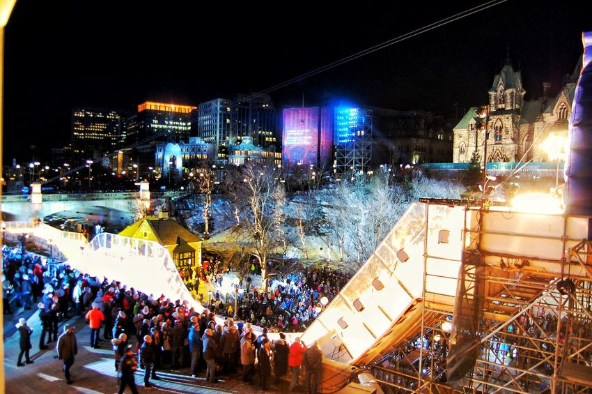 Large Group Of People Illuminated Crowd Night City Popular Music Concert Celebration City Life Outdoors People Travel Destinations Architecture Building Exterior Match - Sport Ice Rink Adult Adults Only Redbullcrashedice RedbullEvents RedBull Ottawa 150e Canada The Street Photographer - 2017 EyeEm Awards The Photojournalist - 2017 EyeEm Awards