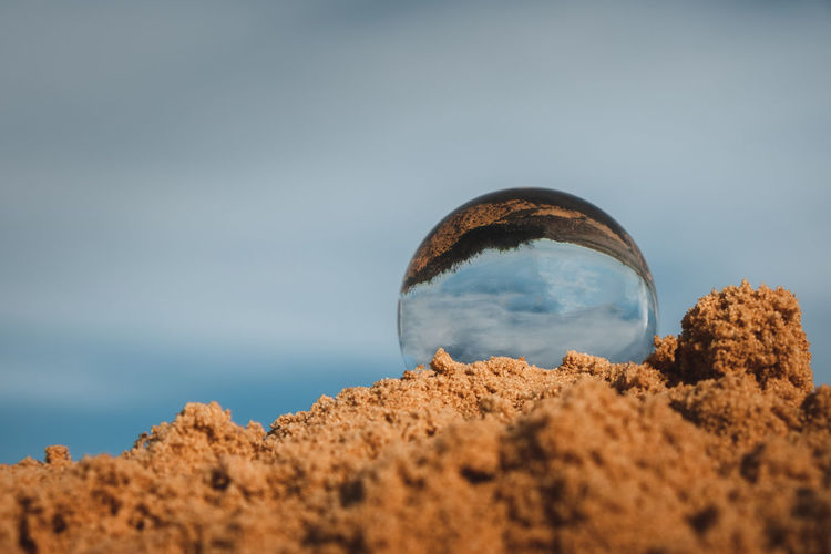 Low angle view of sand on beach against sky
