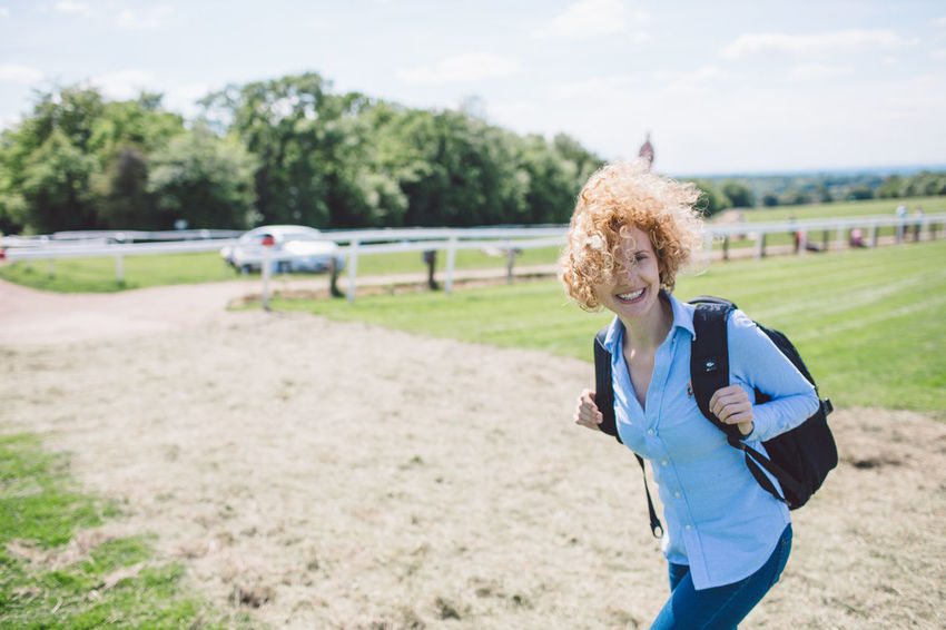 Backpack Curly Hair Epsom Downs Racecourse Girl Horse Race Race Track Smiling Sunny Let's Go. Together.