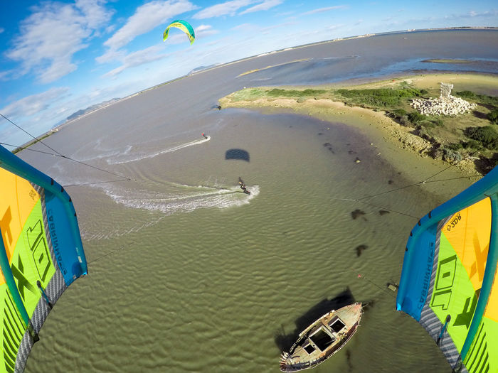 Aerial View Beach Day Extreme Sports Flying Hot Air Balloon Kiteboarding Landscape Nature No People Outdoors Parachute Sand Scenics Sea Sky Sport Sunlight Travel Destinations Water Wave